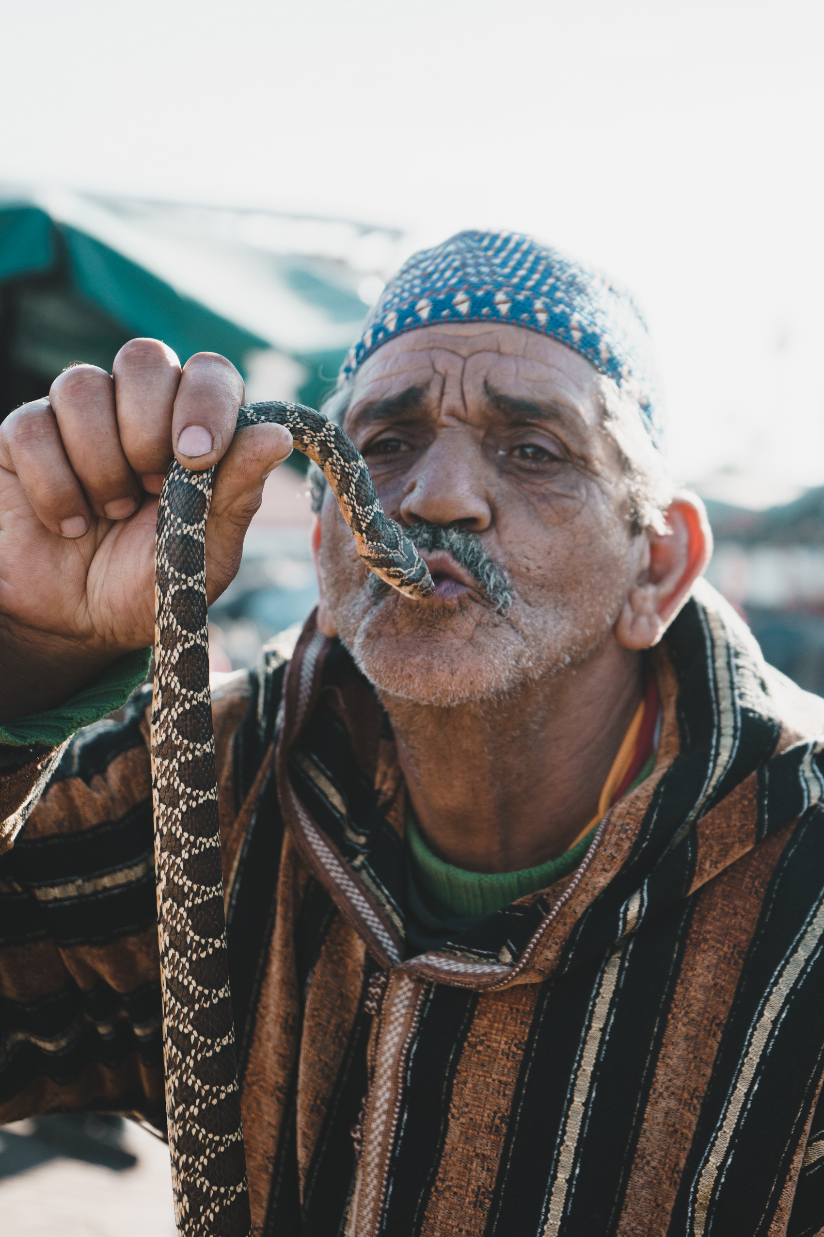 Snake Charmer at Jemaa el-Fnaa Night Market in Marrakech, Morocco